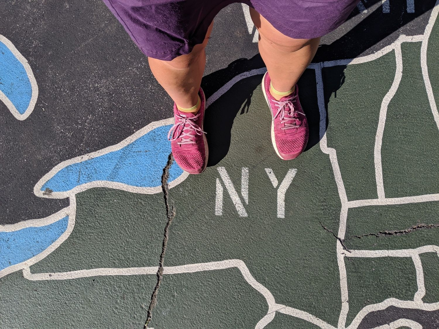 Liz Thomas wearing the Altra Paradigm on a painted sidewalk in New York City.