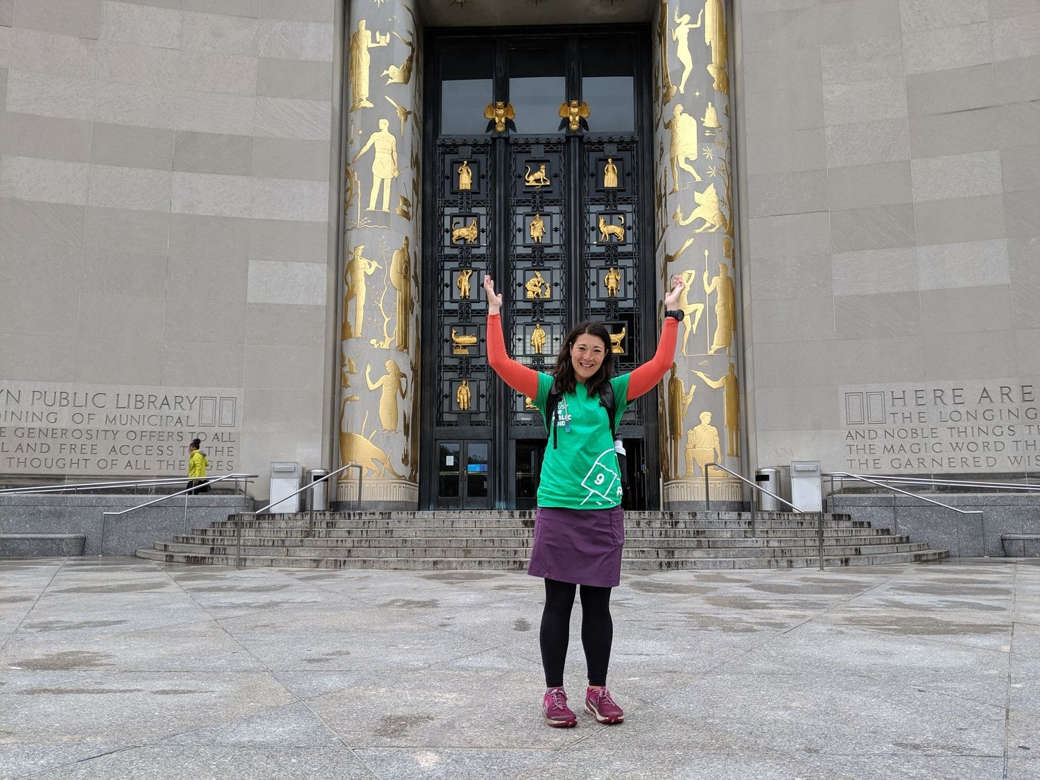 Liz Thomas wearing the Lululemon Wunder Under tights standing in front of the library in New York City.