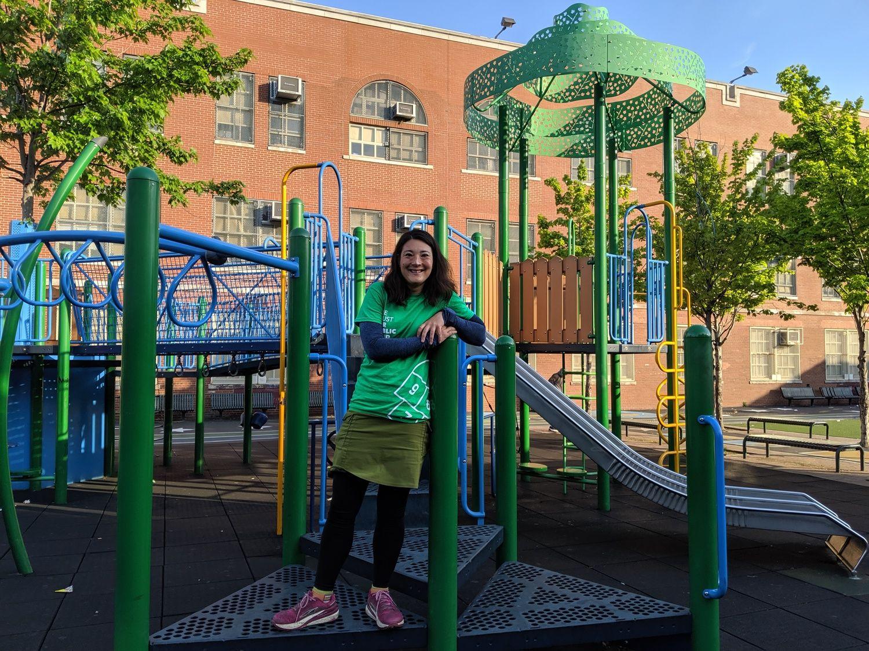 Liz Thomas wearing the Purple Rain Adventure Skirt in a playground in New York City.