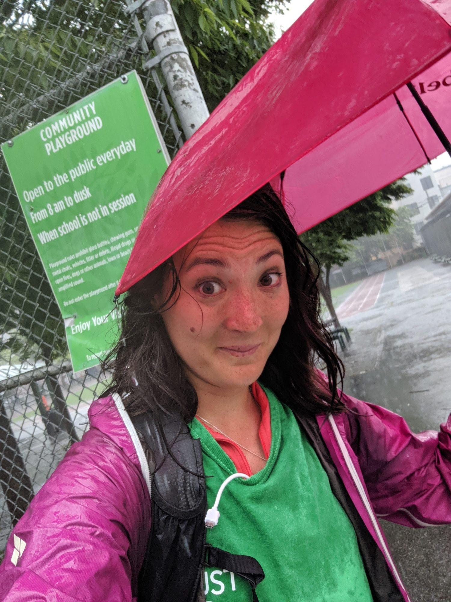 Liz Thomas using the Montbell UL Trekking umbrella during a rainstorm in New York City.