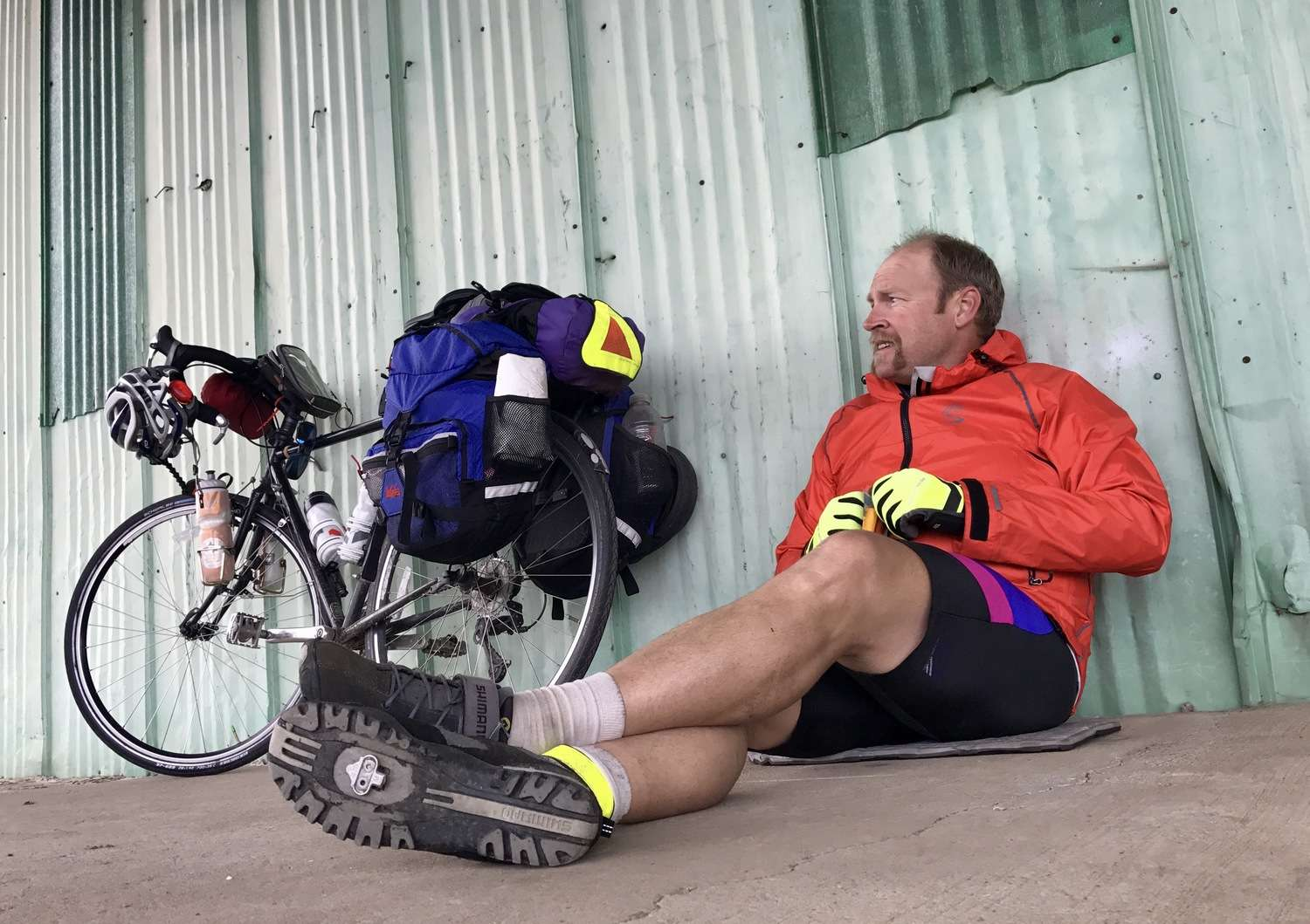 Resting off the bike. Still wearing the bike shoes.   Photo courtesy Brandon Lampley