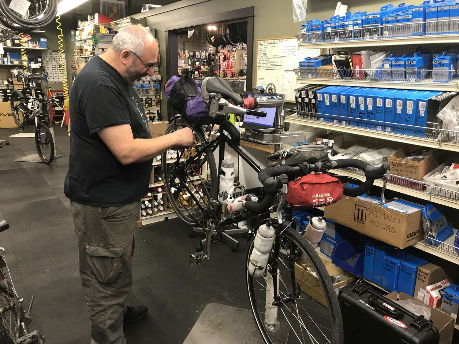 Bike shops along major touring routes are happy to help you with major and minor repair.   Photo courtesy Brandon Lampley.