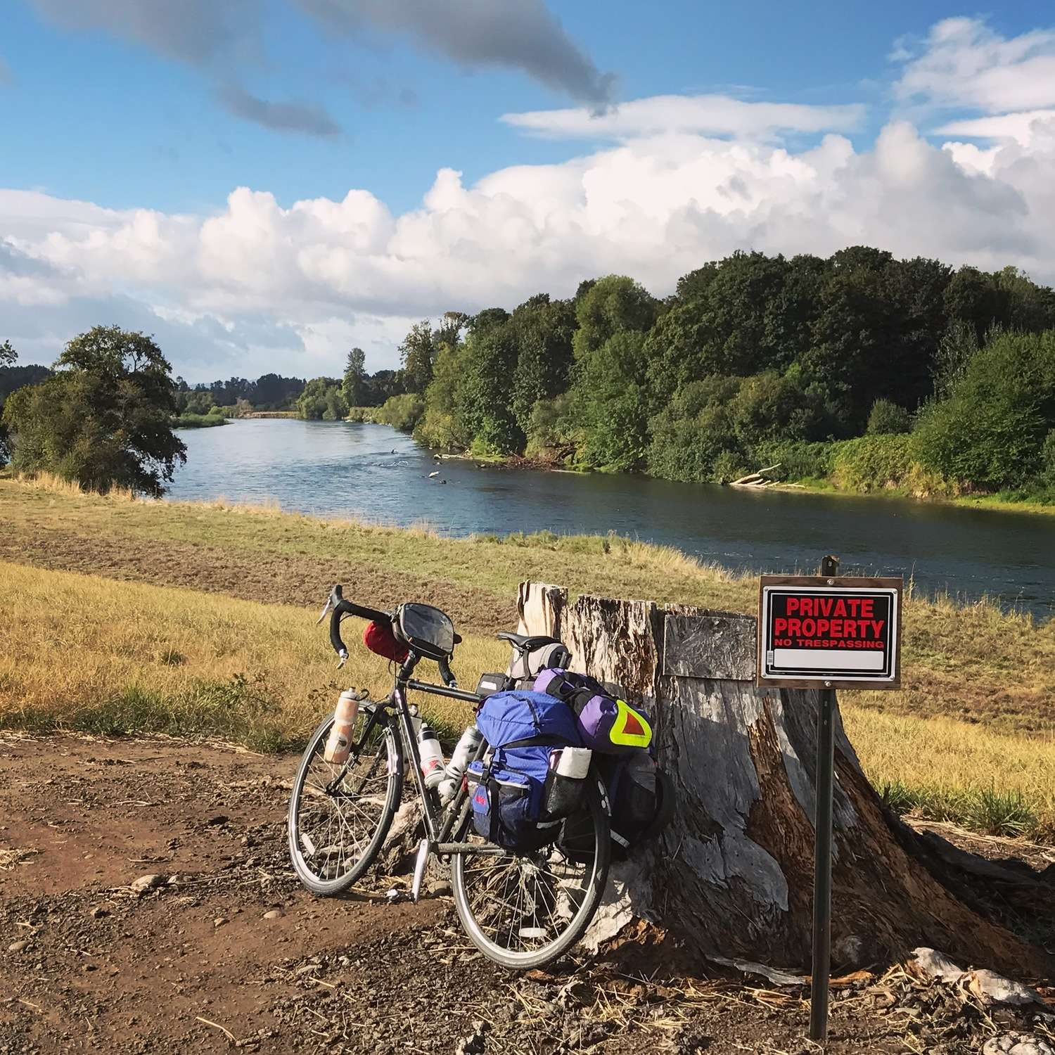 A pedal with clip on one side, flat platform on the other allows you comfort to ride in your bicycle shoes or short rides in sandals to jump in the river . . . and then make a quick get-away.   Photo courtesy Brandon Lampley.