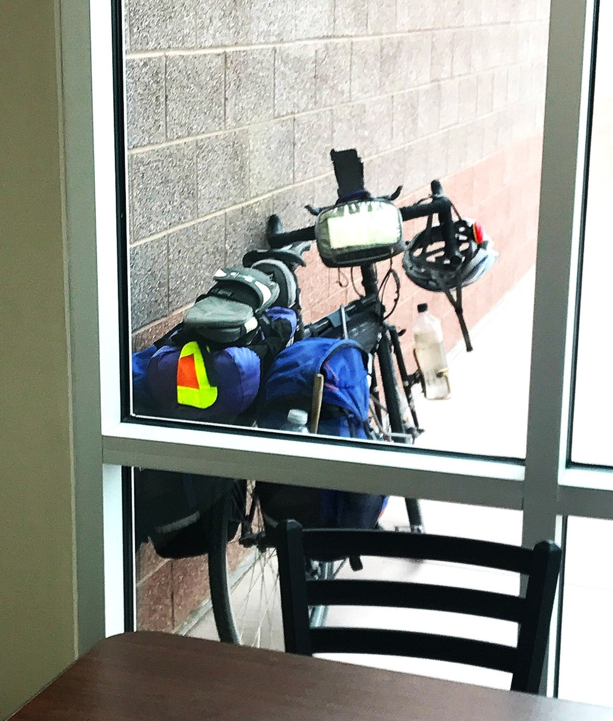 To prevent against theft, some bicycle tourists will choose seats at restaurants that look out on their bikes.   Photo courtesy Brandon Lampley.