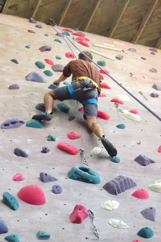 The Singing Rock Onyx being testing on a rock climbing wall indoors.   Photo by Liz Thomas.
