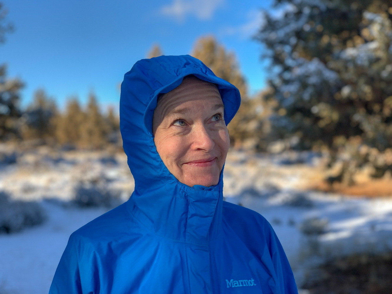 The Marmot Precip rain jacket features a brim along its hood.   Photo by Robert Curzon