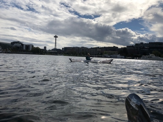 A lengthwise view of the Oru kayak on the water, with the Space Needle in the distance.   Photo by Hannah Weinberger .