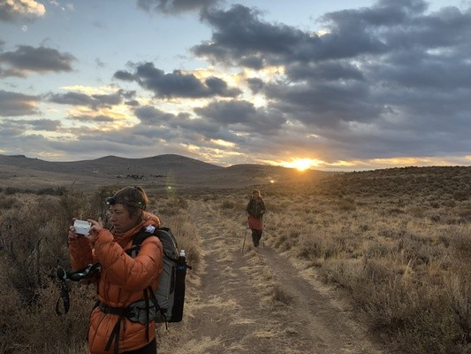 Treeline Review contributing writer Katie Gerber uses the iPhone 8 on the Oregon Desert Trail.   Photo by Whitney LaRuffa.