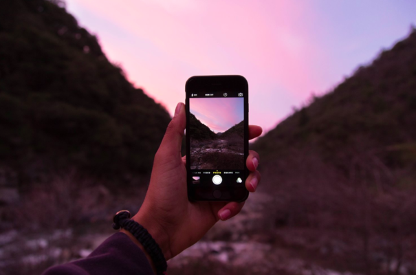 The iPhone seen here taking a photo at sunset. Photo by  Jordan McQueen  on  Unsplash