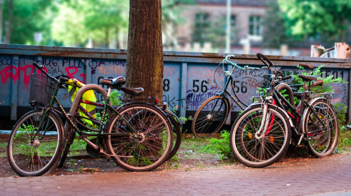 Bikes locked to steel posts.  Photo by    Nathan Wright    on    Unsplash