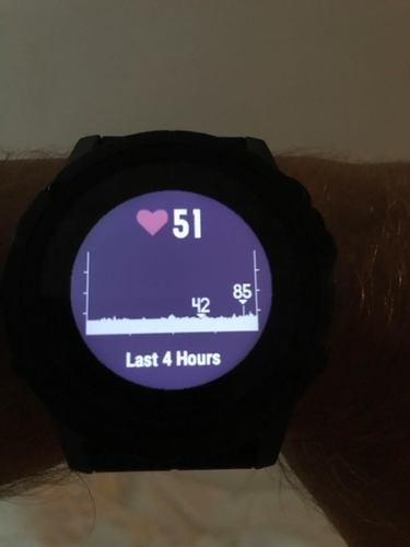 A close up view of the Garmin Fenix 5X Plus with heart rate information.