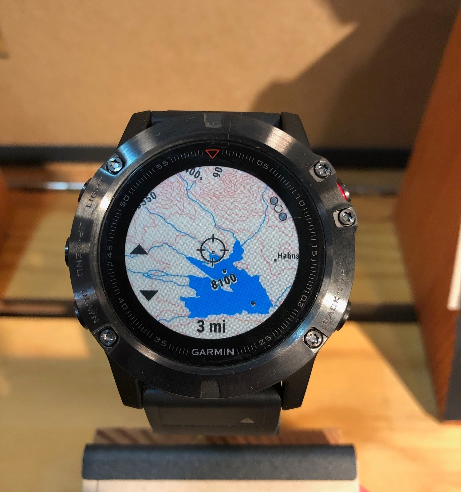 A close up view of the Garmin Fenix 5X Plus with mapping data.