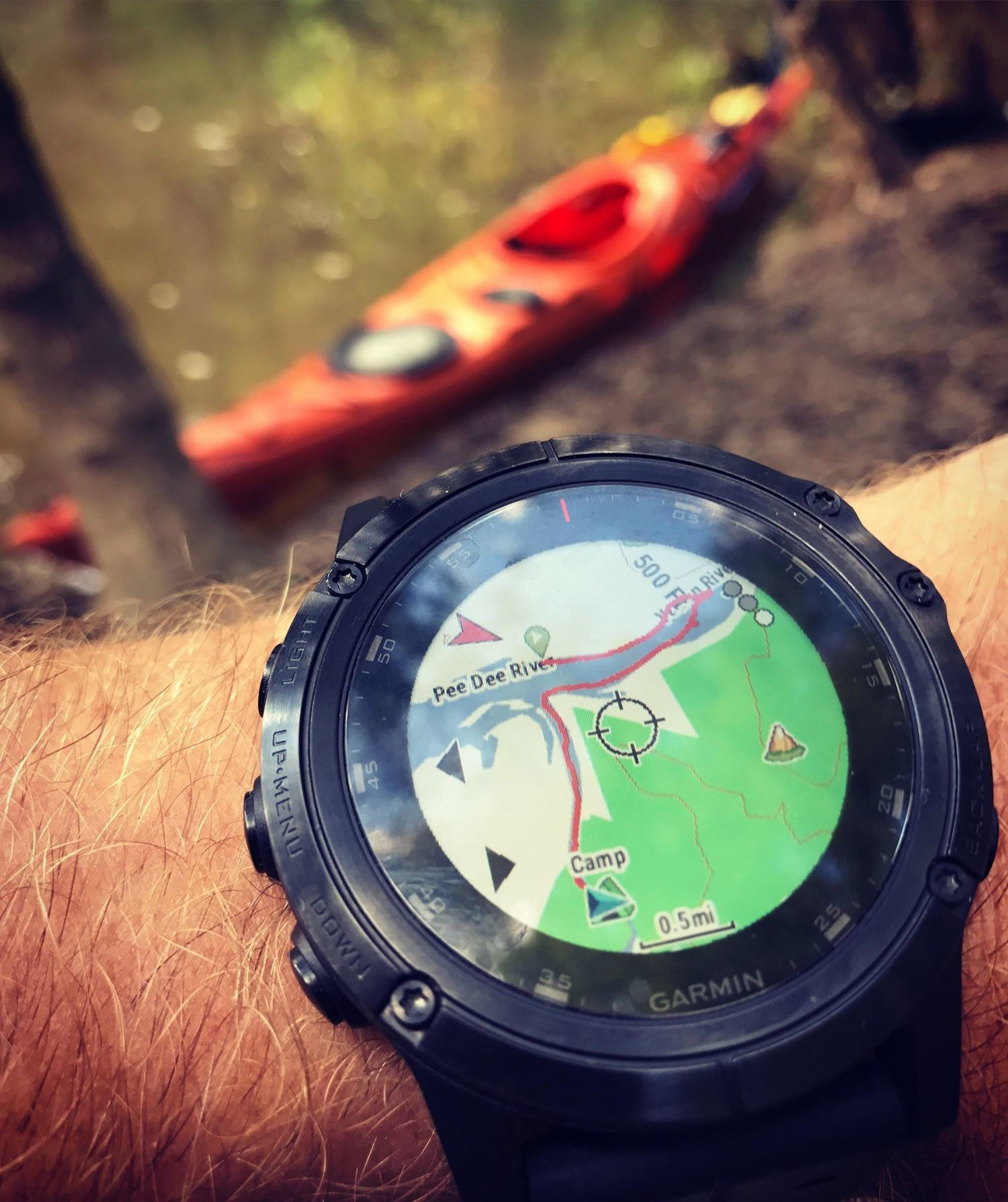 The Garmin Fenix 5X Plus is on a test run kayak trip.
