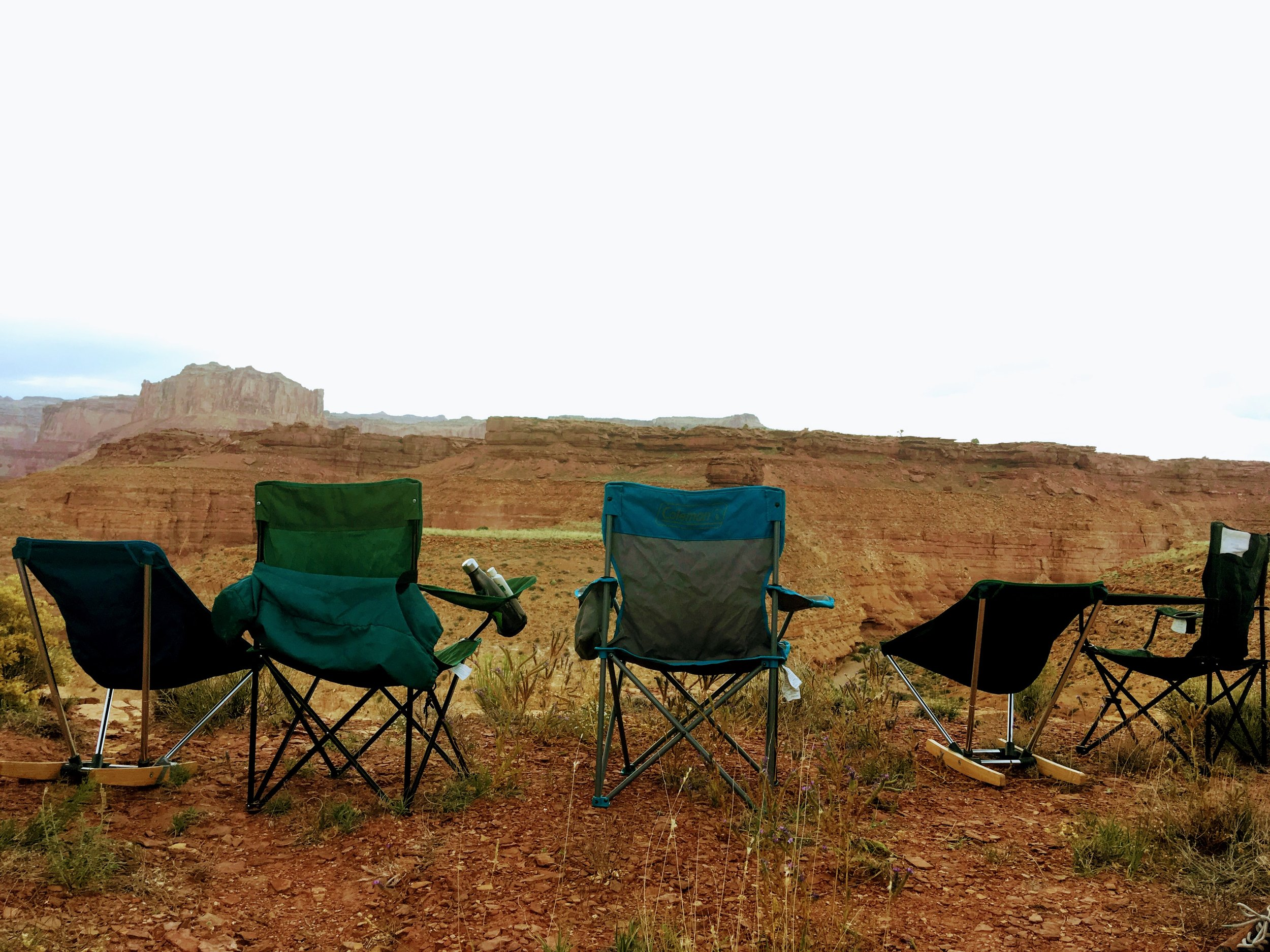 Testing camp chairs with a view.   Photo courtesy Josette Deschambeault