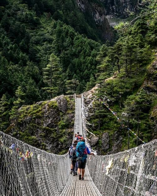 People crossing a footbridge.
