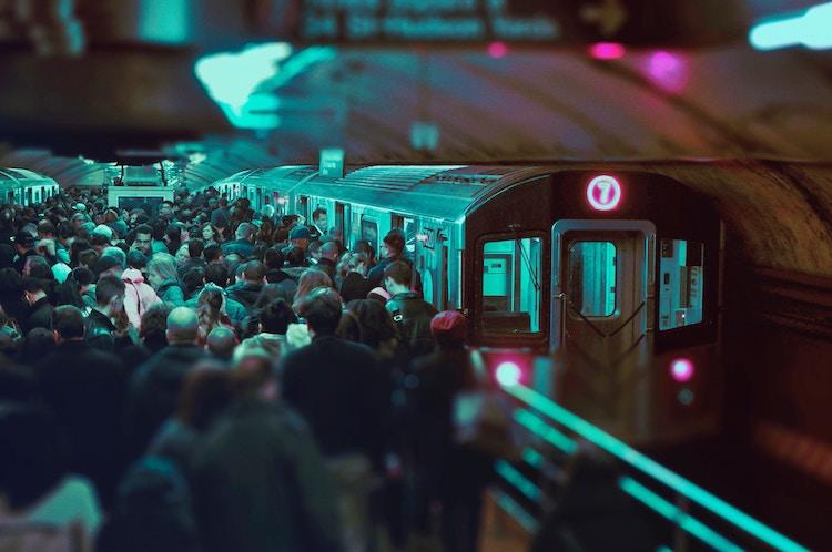 A crowded subway platform scene.
