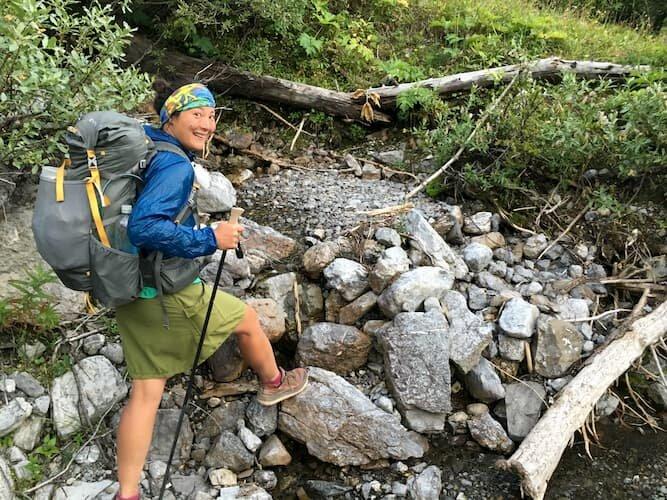 Happy hiker wearing a Buff
