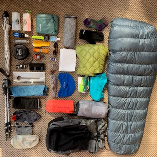 Aerial view of a complete backpacking gear kit