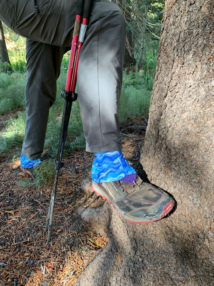 Dirty Girl Gaiters on hiker next to bear scat