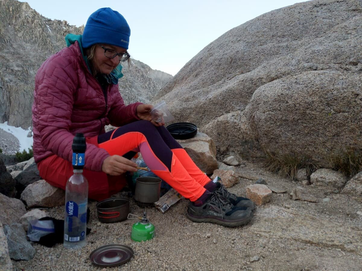 Making coffee in camp in the Patagonia Micropuff.   Photo by Liz Thomas
