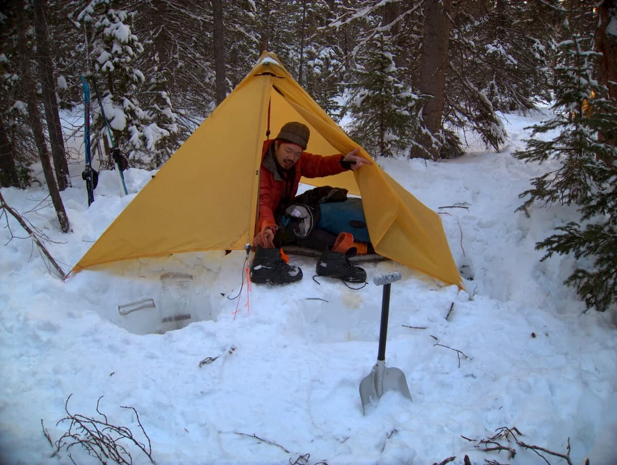 Treeline writer Dunan Cheung testing the Therm-a-Rest NeoAir XTherm in the snow.   Photo courtesy Duncan Cheung