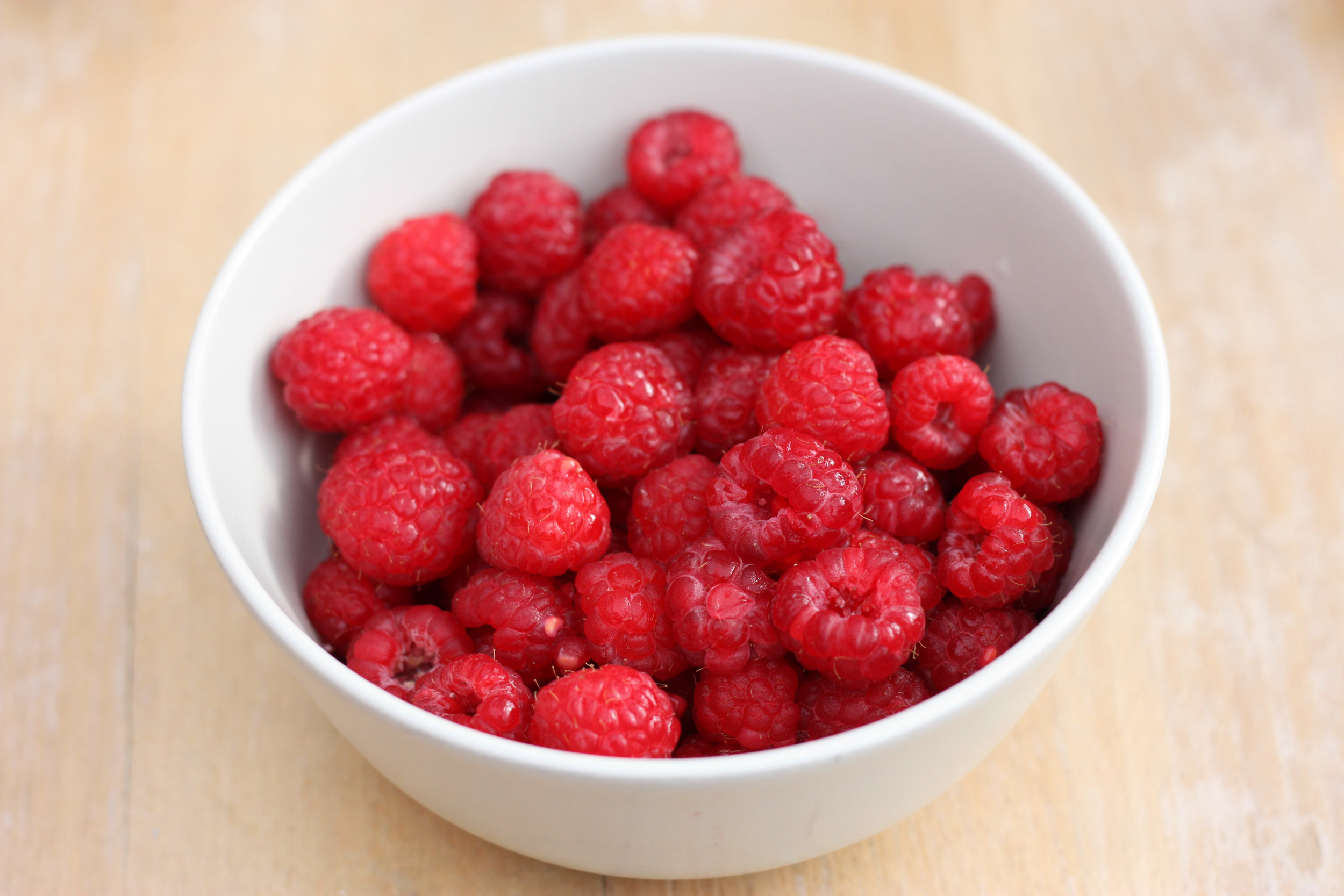 Canva - Selective Focus Photography of Raspberries in White Ceramic Bowl.jpg