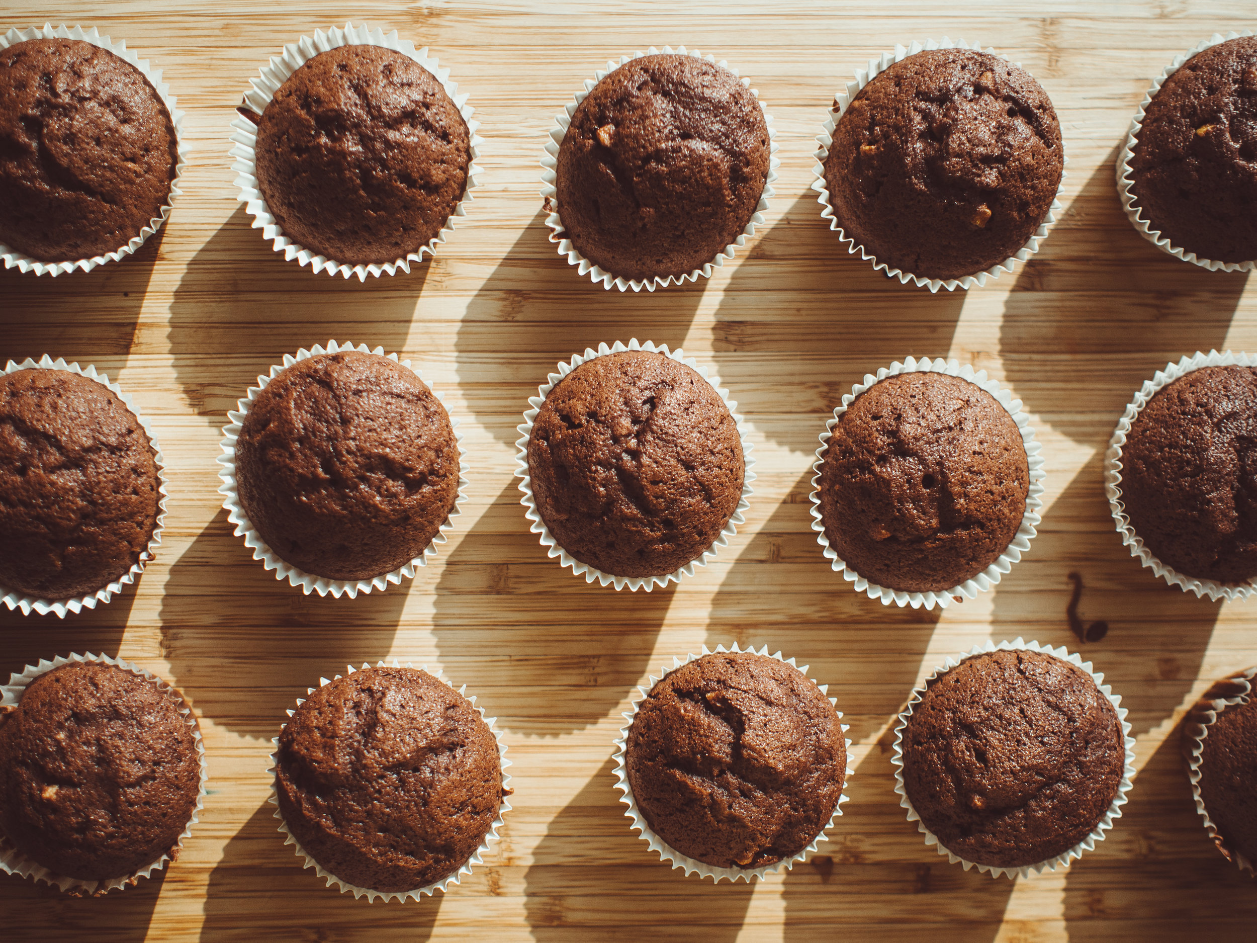 Canva - Chocolate Cupcakes on Brown Wooden Board.jpg