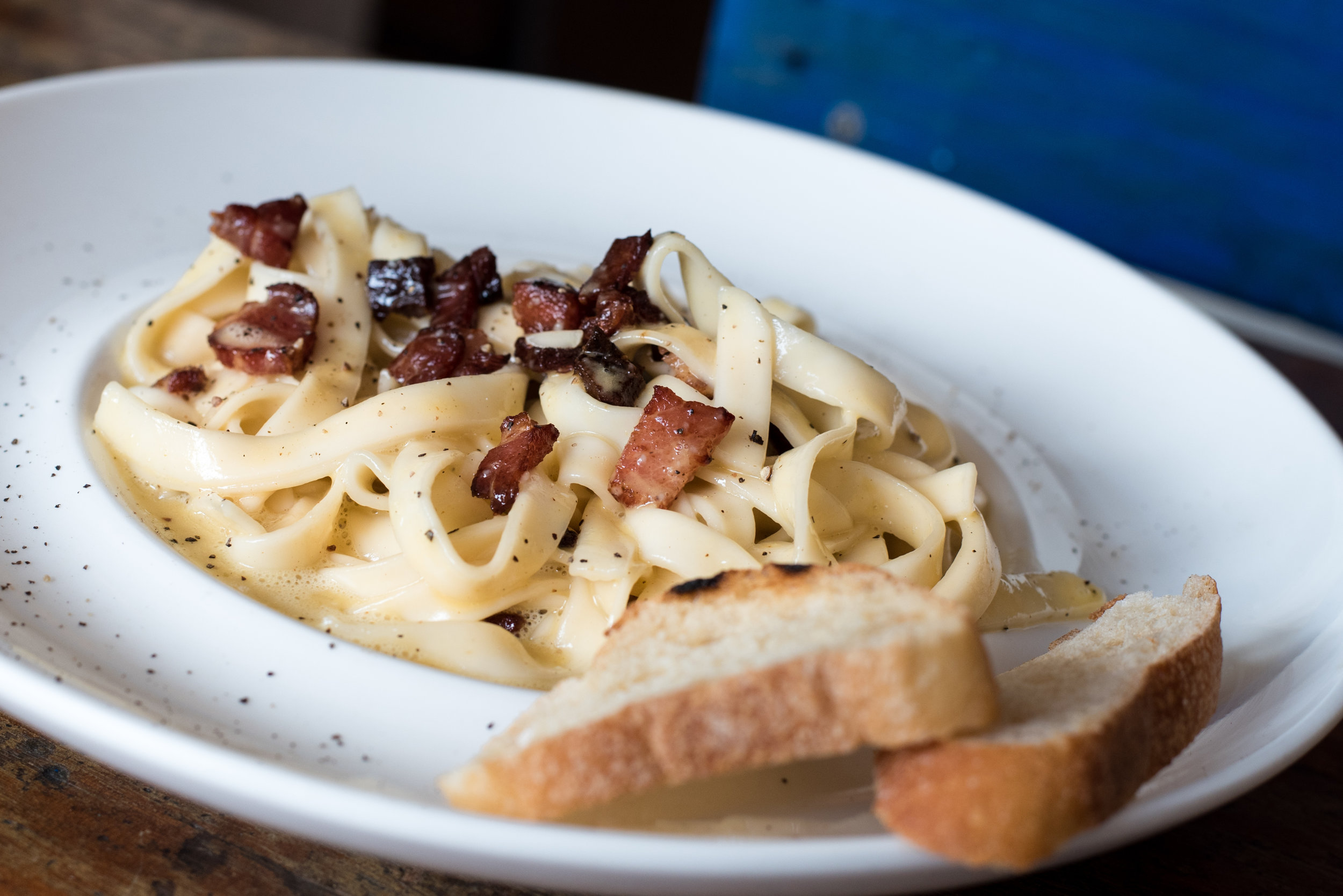 Canva - Pasta Dish With Bread on White Ceramic Plate.jpg
