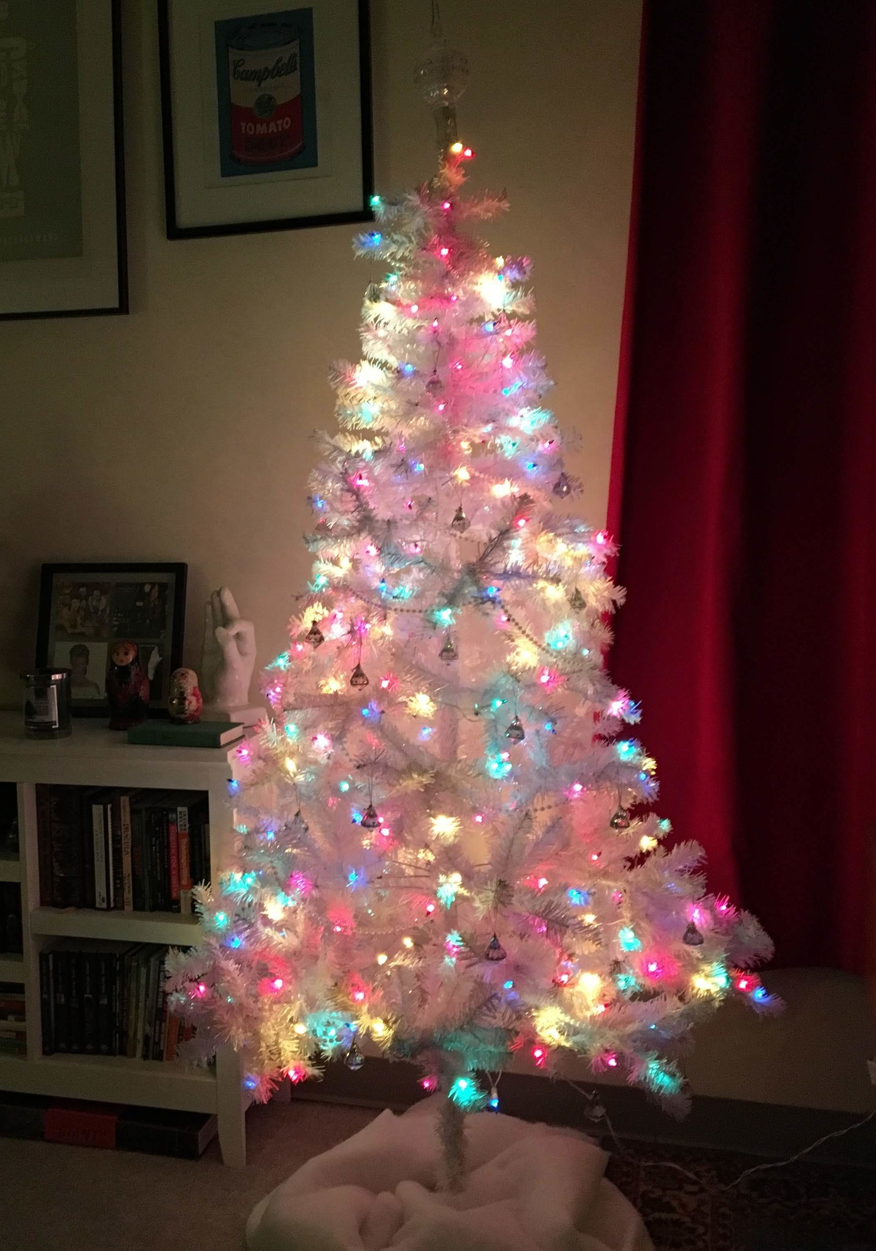 Things I love about this Christmas tree: - - I won it- Doesn't drop pine needles- The colors aren't exclusively Christmassy, so I can use it for other holidays. I'm thinking an Easter Egg tree?! - I only had to sacrifice 1/2 of my dining space to fit it in my tiny-ass apartment.- I can put presents under it- It's mine and I won it