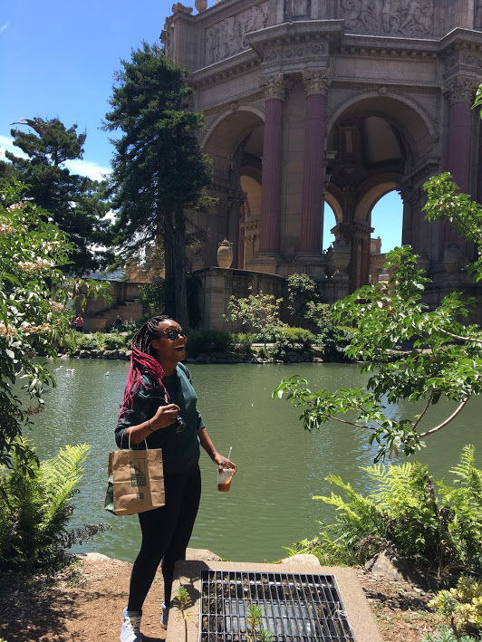Aisha laughing in front of the Palace of Fine Arts