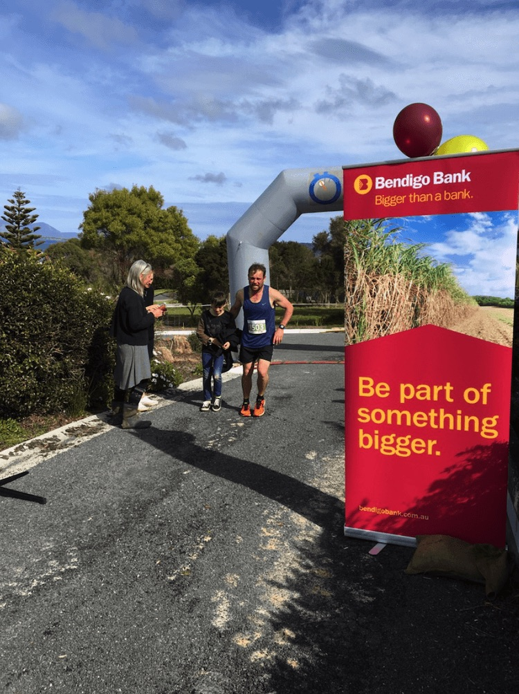 Fig 2 Brett Blythe, winner of the Pub to Pub 2017, crossed the finish line and was greeted by his young son.
