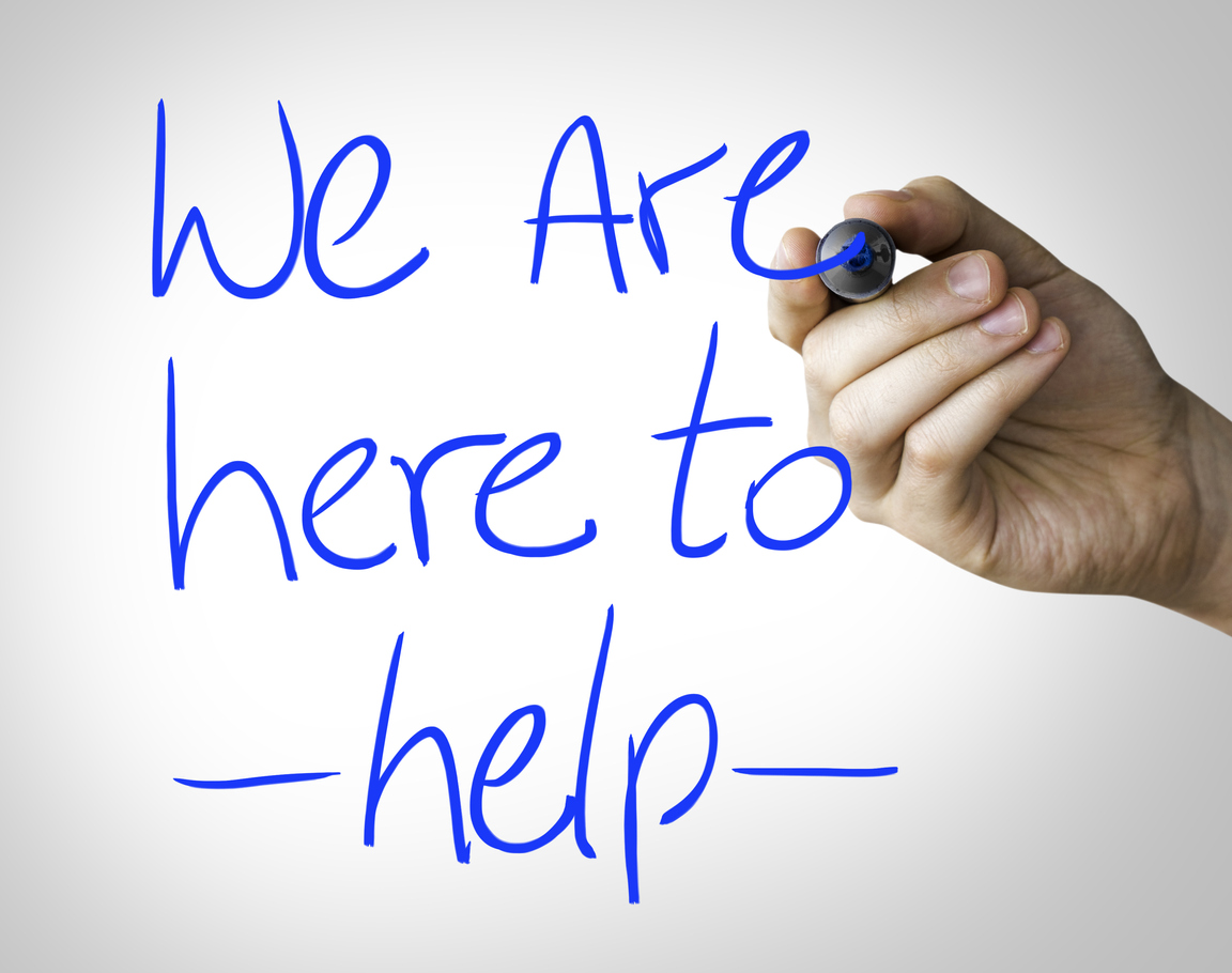 Someone writes on a glass window in blue 'we are here to help'. Which we are, with all your asbestos removal converns