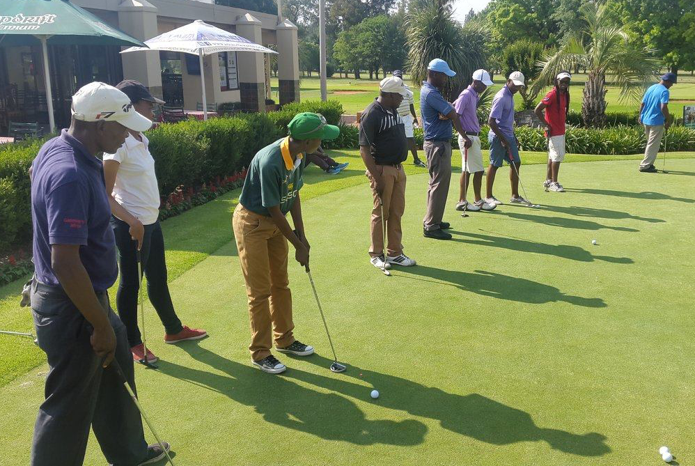 momemtum golf standing in a line.png