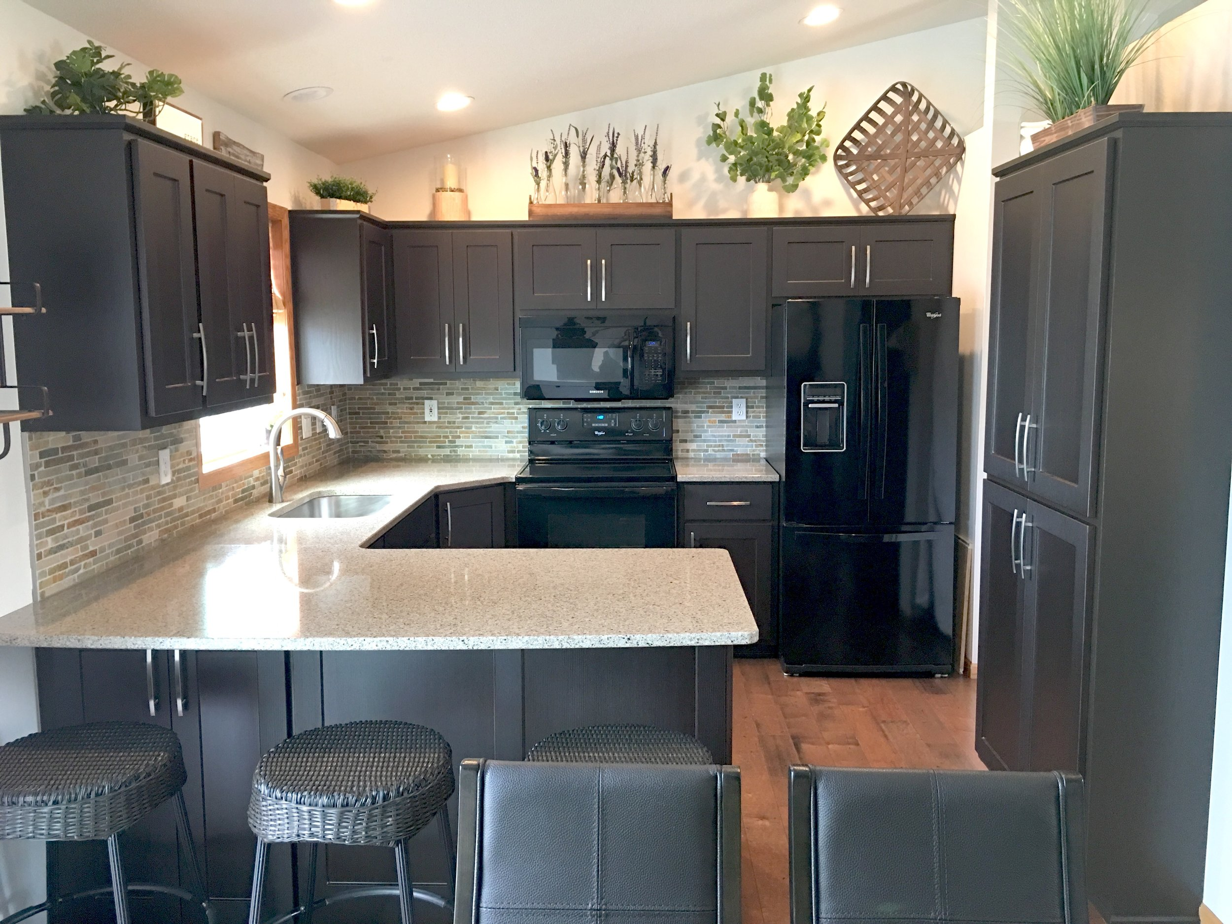 AFTER: Our rich, dark Zanno Wenge on all new doors and drawer fronts converted the existing cabinets of this kitchen from dated to divine!