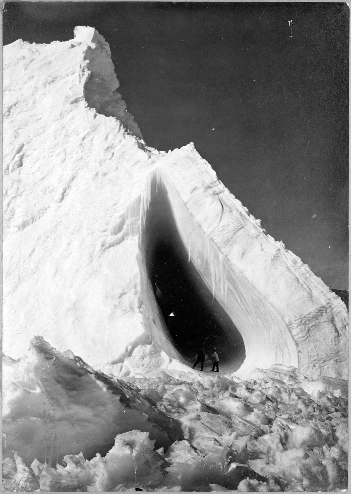 Thomas Griffith Taylor and Charles S. Wright stand in the mouth of the Grotto Iceberg. They both survived Scott's 1910  Terra Nova  expedition. Photo by Herbert G. Ponting/ Library of Congress