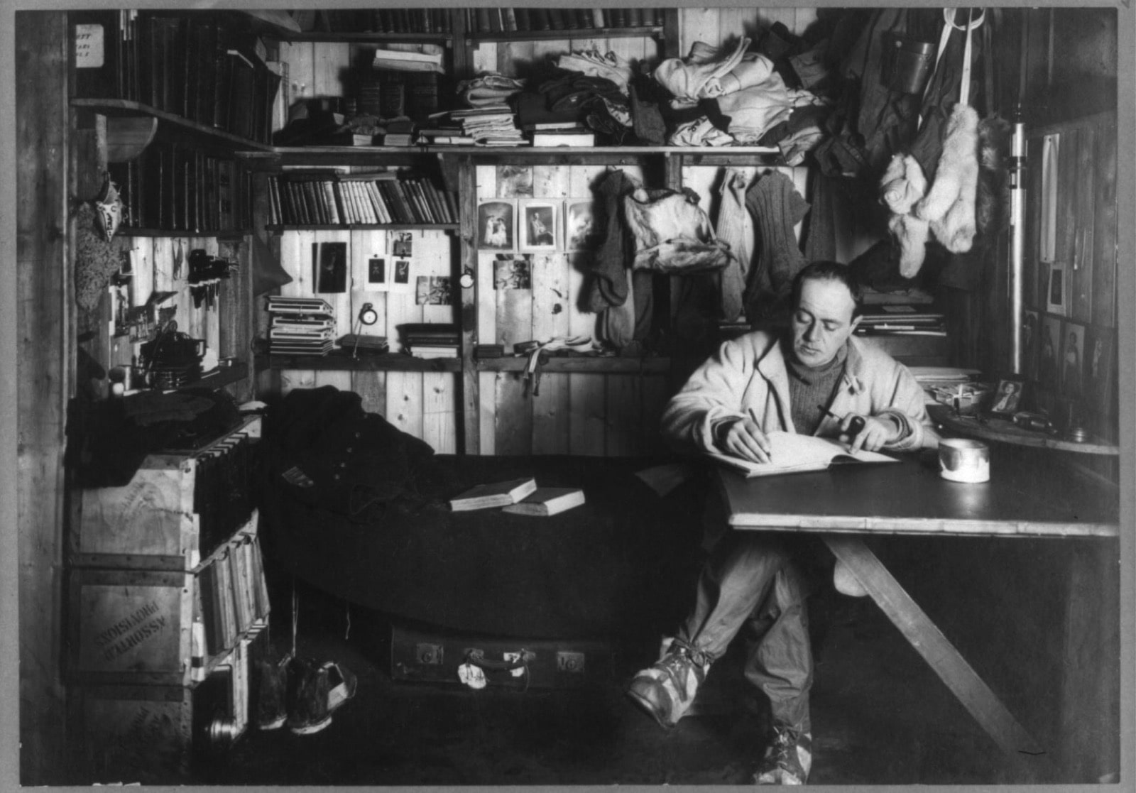 Scott writes some of his last words in his diary. While he ultimately reached the South Pole along with four other members of the crew, a Norwegian team  beat  him by about 33 days. Scott and the other men in his party died on the return journey. Photo by Herbert G. Ponting/ Library of Congress