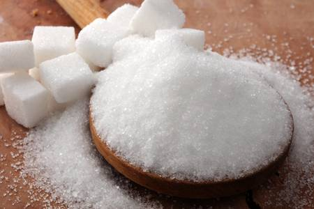 91453960-cubes-of-sugar-and-granulated-sugar-with-wooden-spoon-.jpg