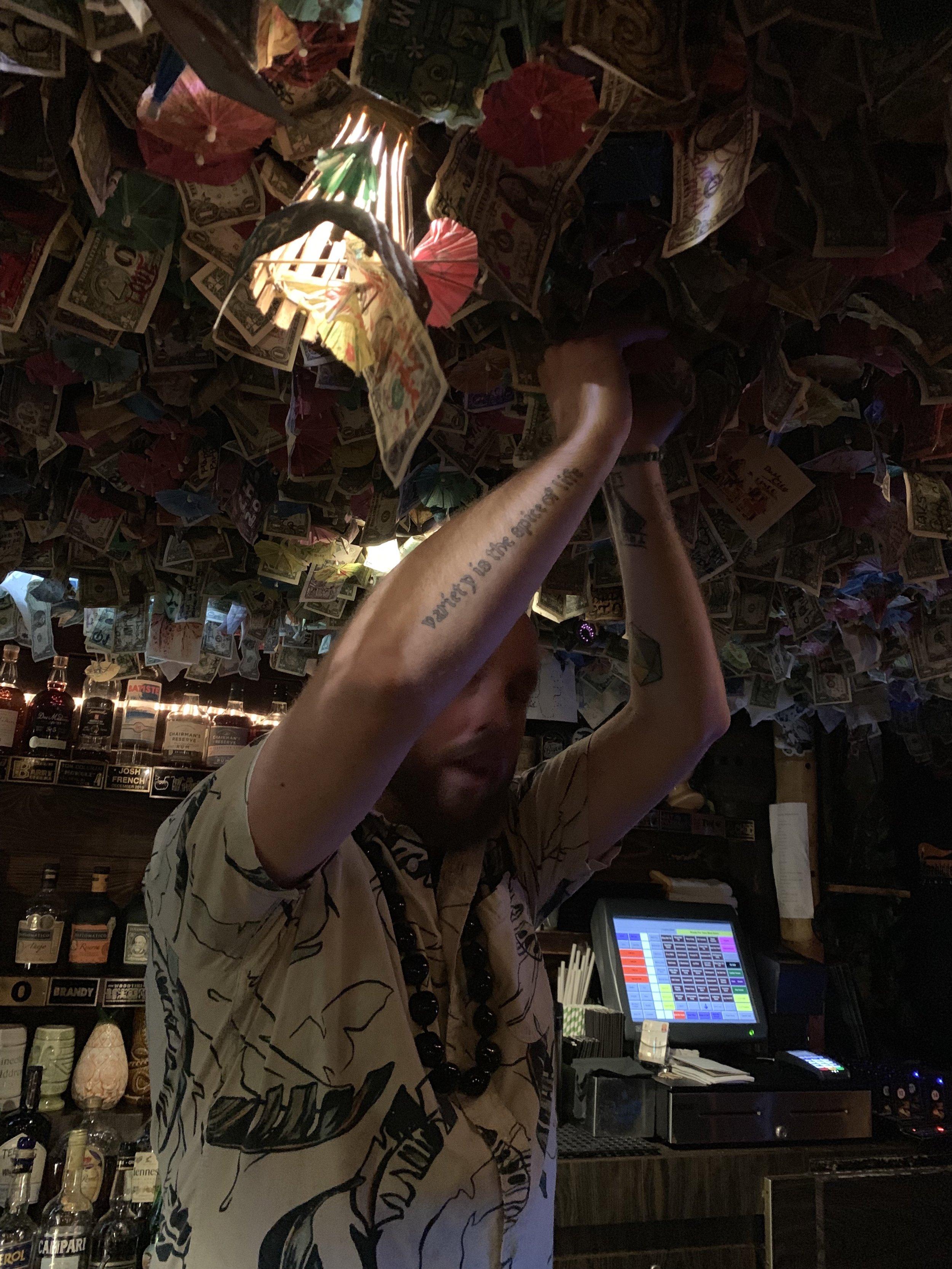 John Helping us Hang our Dollar