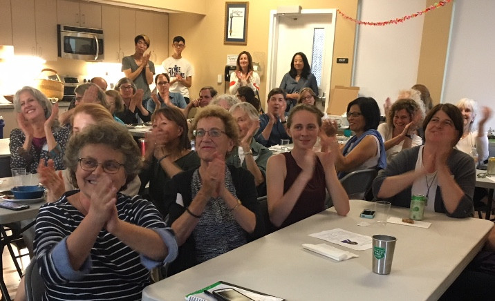 Sister District CA Peninsula members listen to Claudette Williams speaking to us via Skype, during our July meeting.