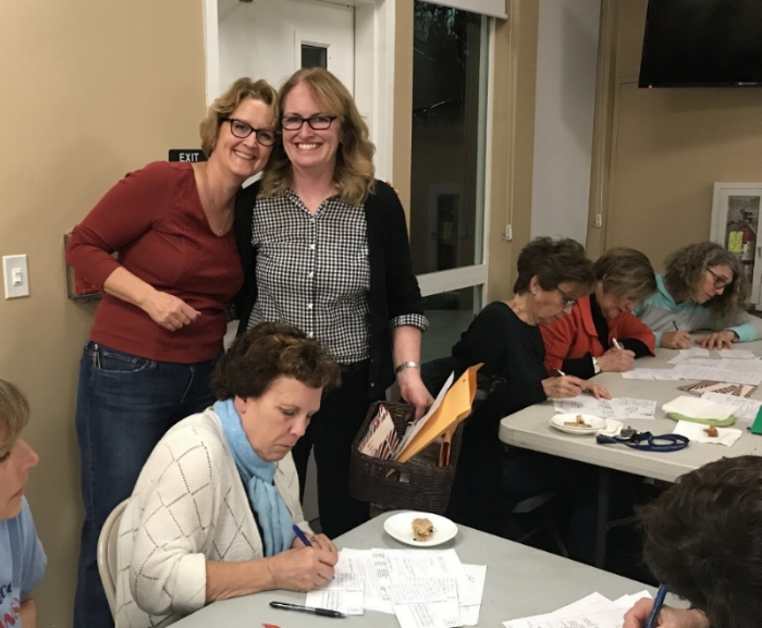 Maureen Murphy and Betsy Adams, District Captain Heads of Postcards, at a postcard writing party in May 2018.