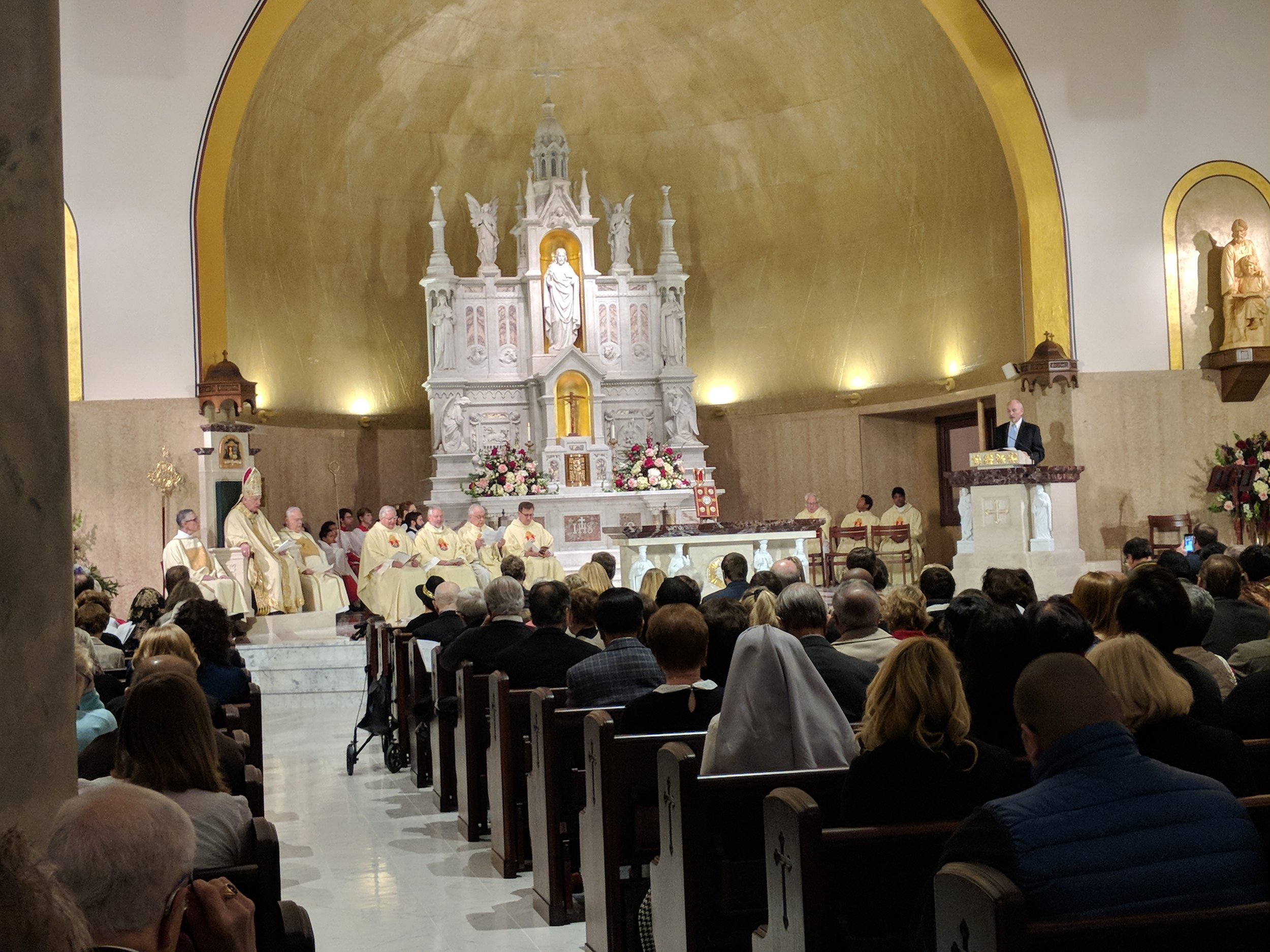 A lector reads from the Pulpit during the dedication mass.