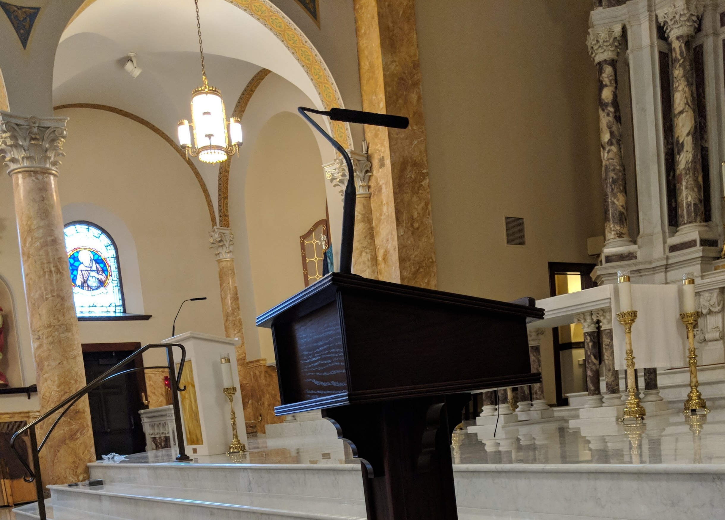 The cantor's podium has been hardwired with a microphone connection and is utilizing an Audio-Technica Engineered series microphone.