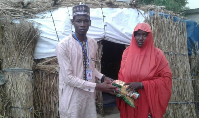 BBI Ambassador Sadiq Modukura delivering food to refugee from Boko Haram