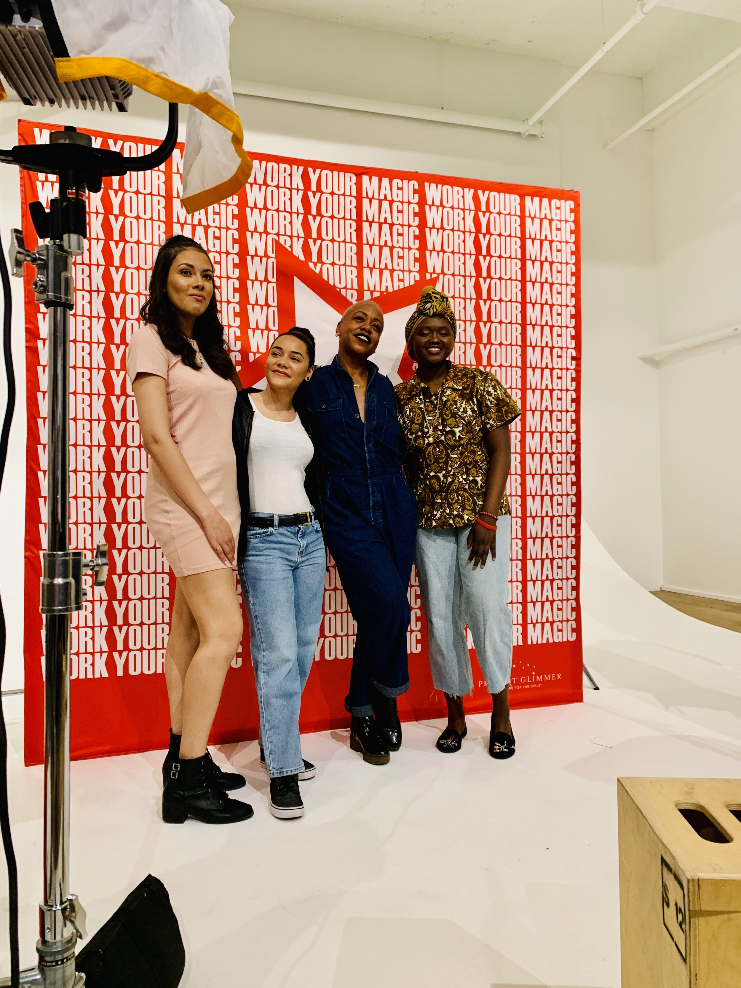 Mentor Manushka Magloire of Afropunk poses with Day of Empowerment attendees in front of the step & repeat wall.