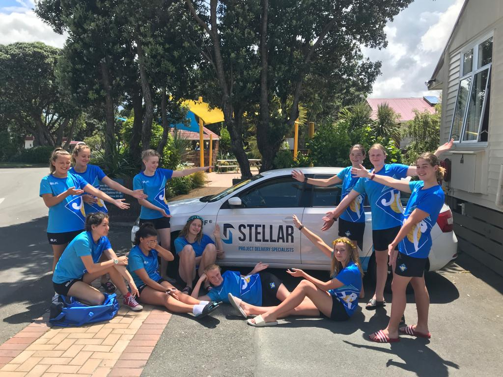 Our Under 14 Gold Girls in Wellington with their car provided by Stellar Projects