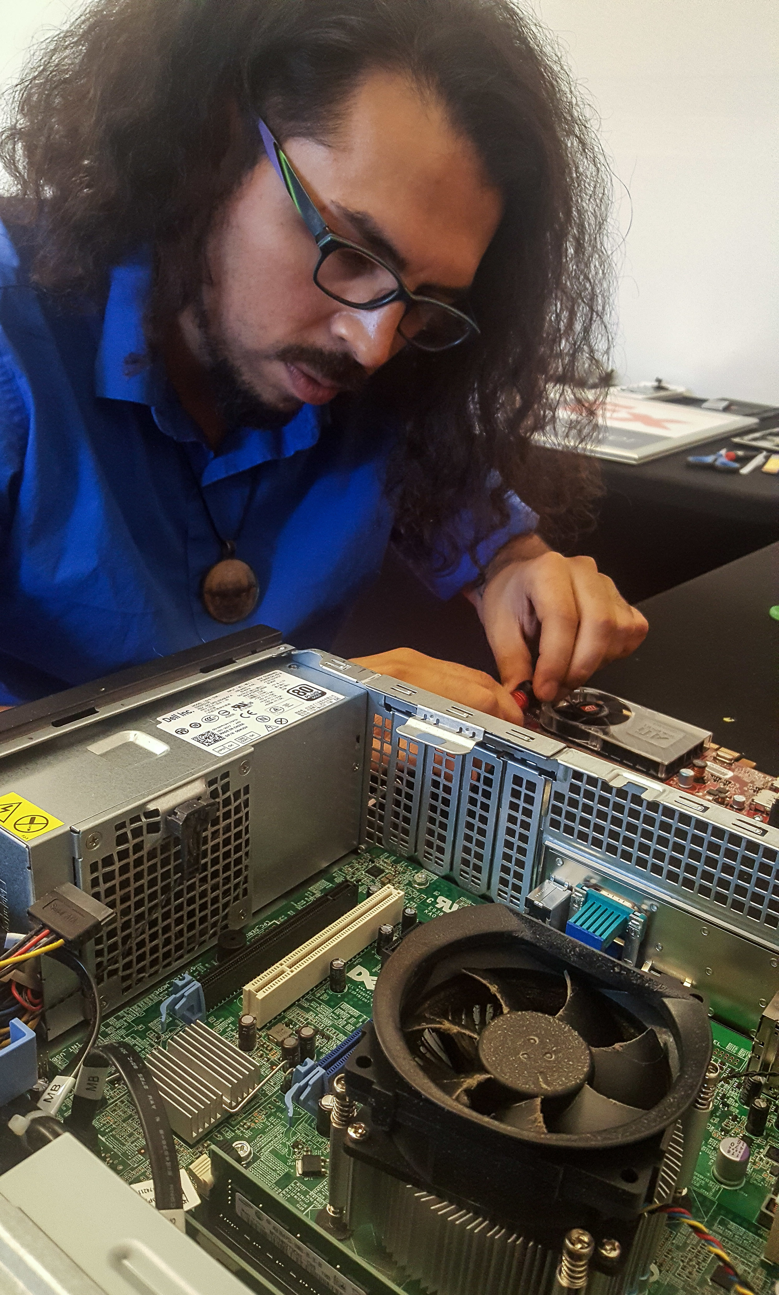 BadApple Owner Leo Trujillo Repairing a broken Computer