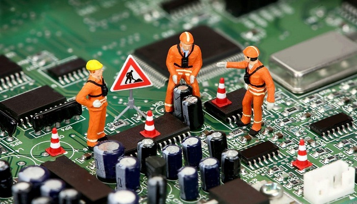 Working on computer motherboard - BadApple Repairs
