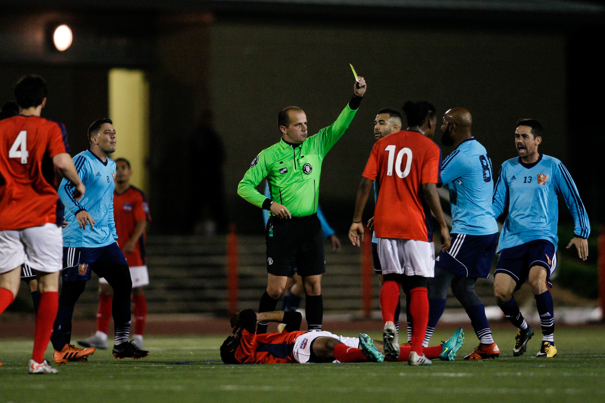 Somerville, MA: A Safira player is shown yellow after a harsh challenge. Safira FC defeated Boston City FC 4-1 in a 2019 Lamar Hunt U.S. Open Cup game on October 20, 2018. (c) Burt Granofsky
