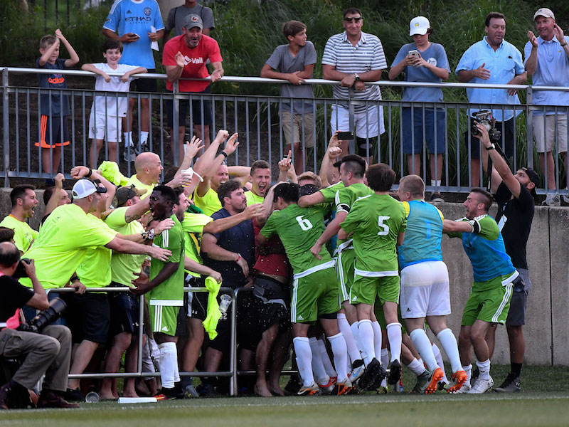 Christos fans celebrating with the club after scoring against DC United. (Courtesy of SI)