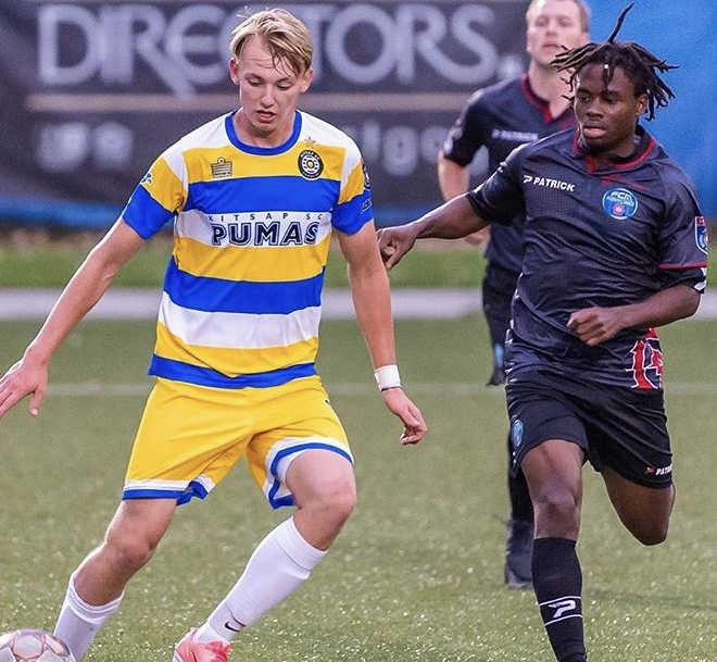 FCMP's Jay Garmondeh (right) decked out in the club's primary kit taking on a Kitsap Pumas player during a NPSL Northwest matchup (Photo: Kitsap Pumas social media)